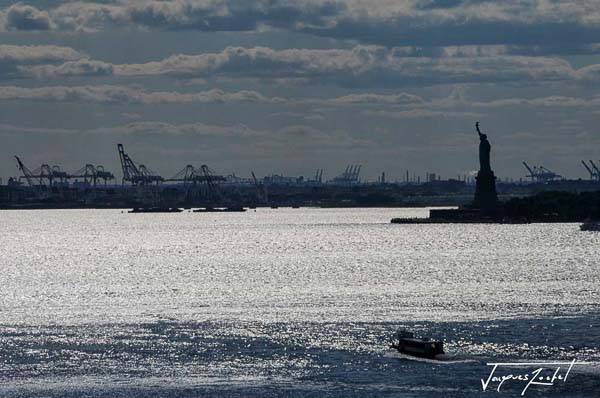 In the bay of New York, the statue of freedom in the distance